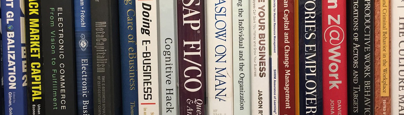 Close up of business books in library stack